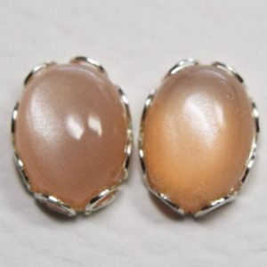 Shop Moonstone Earrings! Peach Moonstone Stud Earrings, 925 Sterling Silver, 8 by 6mm Oval Cabochons, Genuine Moonstone Gems   Natural genuine Moonstone earrings. Buy crystal jewelry, handmade handcrafted artisan jewelry for women.  Unique handmade gift ideas. #jewelry #beadedearrings #beadedjewelry #gift #shopping #handmadejewelry #fashion #style #product #earrings #affiliate #ad