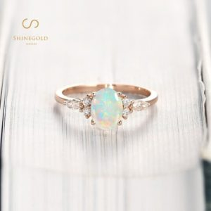 Art deco Opal Engagement Ring, Vintage Moissanite Wedding Ring, Antique Oval Cut Rose Gold Bridal Ring, Delicate Promise Anniversary Ring | Natural genuine Gemstone rings, simple unique alternative gemstone engagement rings. #rings #jewelry #bridal #wedding #jewelryaccessories #engagementrings #weddingideas #affiliate #ad
