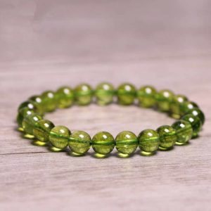 Shop Peridot Jewelry! Peridot Stone Green Crystal Healing Bracelet-Stress Anxiety Relief Anger Therapy Confidence Bracelet-Emotional Balance Strength Bracelet | Natural genuine Peridot jewelry. Buy crystal jewelry, handmade handcrafted artisan jewelry for women.  Unique handmade gift ideas. #jewelry #beadedjewelry #beadedjewelry #gift #shopping #handmadejewelry #fashion #style #product #jewelry #affiliate #ad