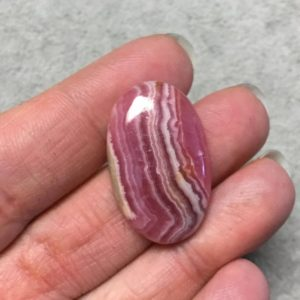 """Shop Rhodochrosite Cabochons! OOAK AAA Rhodochrosite Oblong Oval Shaped Flat Back Cabochon """"2"""" – Measuring 19mm x 31mm, 5mm Dome Height – Natural High Quality Gemstone 