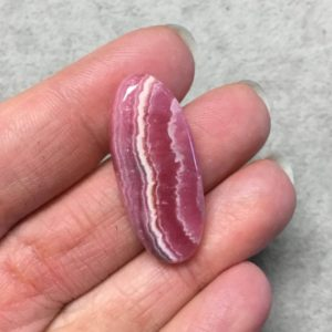"""Shop Rhodochrosite Cabochons! OOAK AAA Rhodochrosite Oblong Oval Shaped Flat Back Cabochon """"5"""" – Measuring 15mm x 34mm, 5mm Dome Height – Natural High Quality Gemstone 