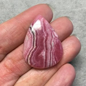 """Shop Rhodochrosite Cabochons! OOAK AAA Rhodochrosite Pear/Teardrop Shaped Flat Back Cabochon """"26"""" – Measuring 27mm x 36mm, 6mm Dome Height – Natural High Quality Gemstone 