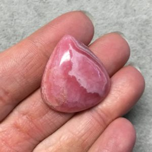 """Shop Rhodochrosite Cabochons! OOAK AAA Rhodochrosite Pear/Teardrop Shaped Flat Back Cabochon """"23"""" – Measuring 27mm x 29mm, 7mm Dome Height – Natural High Quality Gemstone 