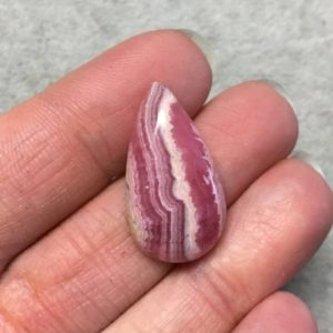 """Shop Rhodochrosite Cabochons! OOAK AAA Rhodochrosite Pear/Teardrop Shaped Flat Back Cabochon """"17"""" – Measuring 16mm x 28mm, 5mm Dome Height – Natural High Quality Gemstone 