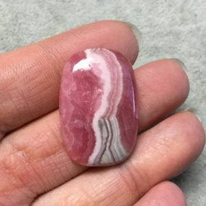 """Shop Rhodochrosite Cabochons! OOAK AAA Rhodochrosite Rectangle Shaped Flat Back Cabochon """"38"""" – Measuring 21mm x 31mm, 5mm Dome Height – Natural High Quality Gemstone 