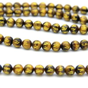 Shop Tiger Eye Bead Shapes! Yellow Tiger Eye OM Beads 8mm 10mm Mala Beads Mandra Beads Natural Tiger Eye Beads Carved Gold Om Beads Om Mani Padme Hum Gemstone Beads | Natural genuine other-shape Tiger Eye beads for beading and jewelry making.  #jewelry #beads #beadedjewelry #diyjewelry #jewelrymaking #beadstore #beading #affiliate #ad