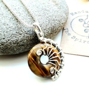 Shop Tiger Eye Pendants! Tigers eye pendant, small silver wire wrap donut necklace, gemstone pendant for success | Natural genuine Tiger Eye pendants. Buy crystal jewelry, handmade handcrafted artisan jewelry for women.  Unique handmade gift ideas. #jewelry #beadedpendants #beadedjewelry #gift #shopping #handmadejewelry #fashion #style #product #pendants #affiliate #ad