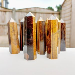 Shop Tiger Eye Points & Wands! Tigers Eye Crystal Tower Point, Protetion, Courage, Meditation, Good Luck, Anxiety, Safe Travel   Natural genuine stones & crystals in various shapes & sizes. Buy raw cut, tumbled, or polished gemstones for making jewelry or crystal healing energy vibration raising reiki stones. #crystals #gemstones #crystalhealing #crystalsandgemstones #energyhealing #affiliate #ad