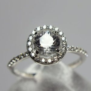 Shop Zircon Rings! Zircon Ring, Engagement, Wedding, Solitaire Ring, Genuine Gemstone 6mm Round 1 Plus ct, Halo of CZ's and Down the Shoulders   Natural genuine Zircon rings, simple unique alternative gemstone engagement rings. #rings #jewelry #bridal #wedding #jewelryaccessories #engagementrings #weddingideas #affiliate #ad