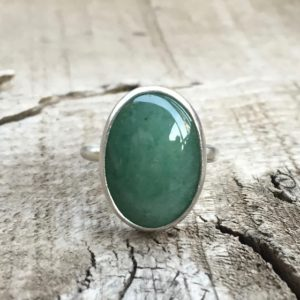 Shop Aventurine Rings! Elegant Oval Emerald Green Aventurine Statement Ring In Sterling Silver | Green Gemstone Ring | Silver Ring | Solitaire Ring | Natural genuine Aventurine rings, simple unique handcrafted gemstone rings. #rings #jewelry #shopping #gift #handmade #fashion #style #affiliate #ad