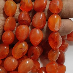 Shop Carnelian Chip & Nugget Beads! Beautiful Natural Carnelian Smooth Nuggets Shape Beads Strand | Carnelian Smooth Nuggets Beads Strand | Carnelian Nuggets Beads Strand | Natural genuine chip Carnelian beads for beading and jewelry making.  #jewelry #beads #beadedjewelry #diyjewelry #jewelrymaking #beadstore #beading #affiliate #ad