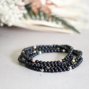 Shop Black Tourmaline Bracelets! Dainty Black Tourmaline Bracelet with Rose Gold Yellow Gold or Silver Spacers 4mm Genuine Stone | Natural genuine Black Tourmaline bracelets. Buy crystal jewelry, handmade handcrafted artisan jewelry for women.  Unique handmade gift ideas. #jewelry #beadedbracelets #beadedjewelry #gift #shopping #handmadejewelry #fashion #style #product #bracelets #affiliate #ad