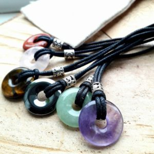 Shop Hematite Pendants! Small Gemstone Pendant, Hematite Donut Necklace, Adjustable Leather Or Vegan Cord, Unisex Gift For Teen | Natural genuine Hematite pendants. Buy crystal jewelry, handmade handcrafted artisan jewelry for women.  Unique handmade gift ideas. #jewelry #beadedpendants #beadedjewelry #gift #shopping #handmadejewelry #fashion #style #product #pendants #affiliate #ad