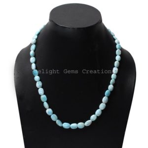 Shop Larimar Necklaces! Dominican Larimar Smooth Oval Nuggets Necklace, 7x9mm-8x11mm Larimar Smooth Tumble Necklace, Larimar Gemstone Beaded Necklace 18-30 Inches   Natural genuine Larimar necklaces. Buy crystal jewelry, handmade handcrafted artisan jewelry for women.  Unique handmade gift ideas. #jewelry #beadednecklaces #beadedjewelry #gift #shopping #handmadejewelry #fashion #style #product #necklaces #affiliate #ad
