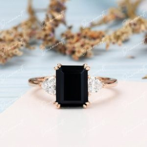 Black Onyx engagement ring 4CT Emerald cut vintage moissanite 14k yellow gold 3 stone engagement ring Bridal ring anniversary gift for women   Natural genuine Array rings, simple unique alternative gemstone engagement rings. #rings #jewelry #bridal #wedding #jewelryaccessories #engagementrings #weddingideas #affiliate #ad