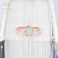 Art Deco Opal Engagement Ring, Unique Oval Cut Rose Gold Bridal Ring, Vintage Marquise Cut Moissanite Wedding Ring, Anniversary Promise Ring | Natural genuine Gemstone jewelry. Buy handcrafted artisan wedding jewelry.  Unique handmade bridal jewelry gift ideas. #jewelry #beadedjewelry #gift #crystaljewelry #shopping #handmadejewelry #wedding #bridal #jewelry #affiliate #ad