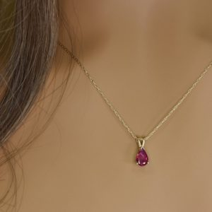 Shop Ruby Pendants! Pear shape NATURAL RUBY NECKLACE, Jewelry gift, Dainty Ruby pendant in Solid 14kt Gold, Birthstone necklace, Anniversary gift for her | Natural genuine Ruby pendants. Buy crystal jewelry, handmade handcrafted artisan jewelry for women.  Unique handmade gift ideas. #jewelry #beadedpendants #beadedjewelry #gift #shopping #handmadejewelry #fashion #style #product #pendants #affiliate #ad
