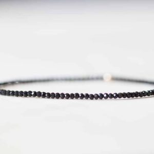 Shop Spinel Jewelry! Black Spinel Stretch Bracelet, Ultra Delicate Faceted Tiny Beads Gemstone Jewelry, Elastic Stacking Bracelet, Simple Minimal | Natural genuine Spinel jewelry. Buy crystal jewelry, handmade handcrafted artisan jewelry for women.  Unique handmade gift ideas. #jewelry #beadedjewelry #beadedjewelry #gift #shopping #handmadejewelry #fashion #style #product #jewelry #affiliate #ad