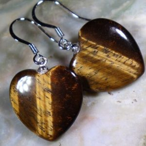 Shop Tiger Eye Earrings! Tigers Eye Hearts Healing Stone Earrings With Positive Healing Energy!   Natural genuine Tiger Eye earrings. Buy crystal jewelry, handmade handcrafted artisan jewelry for women.  Unique handmade gift ideas. #jewelry #beadedearrings #beadedjewelry #gift #shopping #handmadejewelry #fashion #style #product #earrings #affiliate #ad