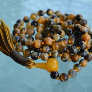 Shop Tiger Eye Necklaces! Rarest AAA Grade Miracle Tiger Eye Hand knotted Mala Necklace – Intution Releases fear Strenghtens Enthusiasm Manifestation Calming Yang | Natural genuine Tiger Eye necklaces. Buy crystal jewelry, handmade handcrafted artisan jewelry for women.  Unique handmade gift ideas. #jewelry #beadednecklaces #beadedjewelry #gift #shopping #handmadejewelry #fashion #style #product #necklaces #affiliate #ad