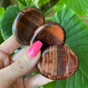 Shop Tiger Eye Shapes! Red Tiger Eye Worry Stone, Pocket Stone | Natural genuine stones & crystals in various shapes & sizes. Buy raw cut, tumbled, or polished gemstones for making jewelry or crystal healing energy vibration raising reiki stones. #crystals #gemstones #crystalhealing #crystalsandgemstones #energyhealing #affiliate #ad