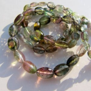 Shop Watermelon Tourmaline Beads! Watermelon tourmaline oval GREEN beads nuggets AAA bicolour bicolor rubellite micro faceted, natural genuine pink green slice slices | Natural genuine faceted Watermelon Tourmaline beads for beading and jewelry making.  #jewelry #beads #beadedjewelry #diyjewelry #jewelrymaking #beadstore #beading #affiliate #ad