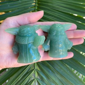 Shop Aventurine Shapes! Yoda Carving, Green Aventurine Yoda, Green Aventurine Baby Yoda Carving, 2 Styles Available   Natural genuine stones & crystals in various shapes & sizes. Buy raw cut, tumbled, or polished gemstones for making jewelry or crystal healing energy vibration raising reiki stones. #crystals #gemstones #crystalhealing #crystalsandgemstones #energyhealing #affiliate #ad
