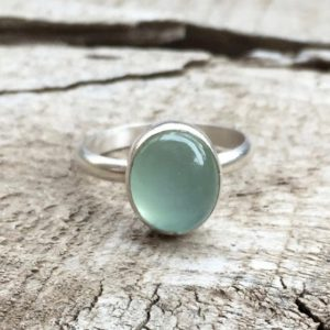 Soft Elegant Romantic Pink Or Aqua Blue Oval Chalcedony Sterling Silver Ring | Pink Chalcedony Ring | Blue Chalcedony Ring | Solitaire Ring | Natural genuine Blue Chalcedony rings, simple unique handcrafted gemstone rings. #rings #jewelry #shopping #gift #handmade #fashion #style #affiliate #ad