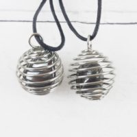 Hematite Gemstone Pendant, Reiki Infused Spiral Cage Crystal Necklace, Self Care Healing Crystals Mindfulness Gift | Natural genuine Gemstone jewelry. Buy crystal jewelry, handmade handcrafted artisan jewelry for women.  Unique handmade gift ideas. #jewelry #beadedjewelry #beadedjewelry #gift #shopping #handmadejewelry #fashion #style #product #jewelry #affiliate #ad
