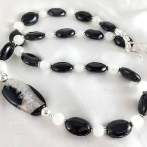 """Shop Obsidian Necklaces! Black & white druzy geode long necklace, asymmetrical design. Obsidian ovals and quartz. Raw crystal jewelry. 22"""" long statement jewelry.   Natural genuine Obsidian necklaces. Buy crystal jewelry, handmade handcrafted artisan jewelry for women.  Unique handmade gift ideas. #jewelry #beadednecklaces #beadedjewelry #gift #shopping #handmadejewelry #fashion #style #product #necklaces #affiliate #ad"""