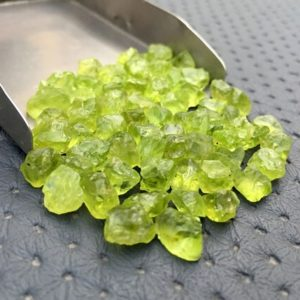 50 Piece Natural Rough 6-8 MM Rough, Bulk Raw Peridot Crystals,Natural Green Peridot Gemstone,Fairy Gardens, Crafting, Jewelry,Peridot Rocks | Natural genuine stones & crystals in various shapes & sizes. Buy raw cut, tumbled, or polished gemstones for making jewelry or crystal healing energy vibration raising reiki stones. #crystals #gemstones #crystalhealing #crystalsandgemstones #energyhealing #affiliate #ad