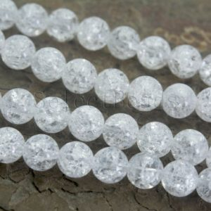 Shop Quartz Crystal Round Beads! crackle clear quartz crystals – ice  rock crystal quartz – white quartz beads –  clear quartz – smooth round cracked beads- 15 inch | Natural genuine round Quartz beads for beading and jewelry making.  #jewelry #beads #beadedjewelry #diyjewelry #jewelrymaking #beadstore #beading #affiliate #ad