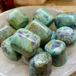 Shop Tumbled Ruby Crystals & Pocket Stones! Premium Hand Polished Ruby and Fuschite  tumbled crystal healing geode   Natural genuine stones & crystals in various shapes & sizes. Buy raw cut, tumbled, or polished gemstones for making jewelry or crystal healing energy vibration raising reiki stones. #crystals #gemstones #crystalhealing #crystalsandgemstones #energyhealing #affiliate #ad