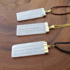 Shop Selenite Jewelry! Raw Selenite Crystal Pendant Necklace – Calming Necklace – Raw Crystal Necklace – Meditation Necklace – Selenite Jewelry   Natural genuine Selenite jewelry. Buy crystal jewelry, handmade handcrafted artisan jewelry for women.  Unique handmade gift ideas. #jewelry #beadedjewelry #beadedjewelry #gift #shopping #handmadejewelry #fashion #style #product #jewelry #affiliate #ad