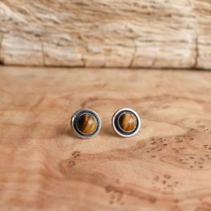 Shop Tiger Eye Earrings! Edge Tigers Eye Posts – Tigers Eye Studs – Silversmith Earrings – Tigers Eye Earrings   Natural genuine Tiger Eye earrings. Buy crystal jewelry, handmade handcrafted artisan jewelry for women.  Unique handmade gift ideas. #jewelry #beadedearrings #beadedjewelry #gift #shopping #handmadejewelry #fashion #style #product #earrings #affiliate #ad